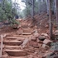 Stairs to your left immediately after the trail sign. - Devils Bridge