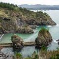 Nellies Cove still has remains of the old boathouse.- Port Orford Coast Guard Station
