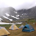 Campers overnighting at Crow Pass.- Crow Pass Trail Thru-Hike