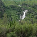 Waterfalls on the slopes beside the Eagle River viewed from the Crow Pass Trail.- Crow Pass Trail Thru-Hike