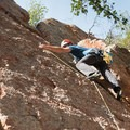 A climber clips the second bolt on Wee Little One (5.8) at Tourist Trap.- Tourist Trap