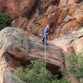 A climber prepares to rappel after setting a walk-up toprope anchor on Rat Race (5.7), reached from the top access trail to Tourist Trap from the High Peaks Trail.- Tourist Trap