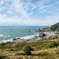 The coastal rocks come into view.- Cape Ferrelo Hike