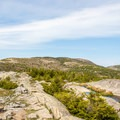 A rocky ridge that you follow. The summit is the highest point on the hills in front of you.- Cadillac Mountain South Ridge Trail