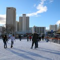 Ice skating with downtown Reno's casinos in the background.- Downtown Reno Ice Rink