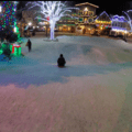 Sledding down under the lights in Front Street Park, Leavenworth.- Front Street Park Sledding