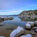 Snow-covered boulders lining the edge of Skunk Harbor.- Skunk Harbor