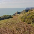 The rocky coastline north of the Coastal Trail.- Fort Cronkhite Loop: Coastal, Wolf Ridge + Miwok Trails