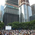 Summer concert series in Bryant Park with the Bank of America Tower under construction.- Bryant Park