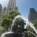 View west to the 792-foot tall Woolworth Building built in 1912.- City Hall Park