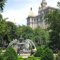 City Hall Park with the 1914-built Manhattan Municipal Building in the distance.- City Hall Park