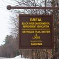 The parking area sign.- Skyfields Ski Trails