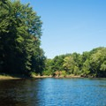 A mixture of farm and forestland lines the banks.- Black River: Lyons Falls to Beeches Landing