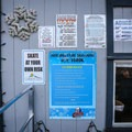 Rules, rates, hours and warnings posted at the ice rink.- Arlington Square Ice Rink