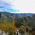 Mount LeConte is visible looking east from the summit.- Chimney Tops