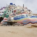 A structure still under construction that you are able to walk into. - Salvation Mountain