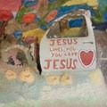 Scrap metal, like this car door, is scattered throughout and used as art pieces. - Salvation Mountain