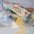 Follow the painted yellow brick road to walk to the top of Salvation Mountain.- Salvation Mountain