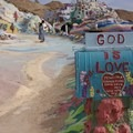 Painted mailbox at the start of the painted yellow brick road.- Salvation Mountain