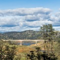 View of the Highway 49 bridge over New Melones.- Heron Point Loop Hike