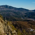 View from the summit of Owl's Head with Hurricane Mountain and its fire tower visible on the left.- Owl's Head