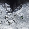 Hiking up the snow-covered Donut Falls.- Donut Falls Snowshoe