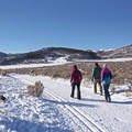 Enjoying a winter hike at the Round Valley Trails.- Round Valley Trails, Quinn's Trailhead