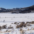 A cross-country skier enjoys the clear weather on the Round Valley Trails.- Round Valley Trails, Quinn's Trailhead