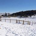 The fenced-in dog run.- North Basin Trails, Woods Trailhead