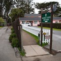 The short trail to the Monarch Butterfly Sanctuary is located to the immediate left of the Butterfly Grove Inn in Pacific Grove.- Monarch Butterfly Sanctuary