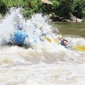 Rafting through the Middle Keeney rapid.- Lower New River Gorge: Cunard to Fayette Station