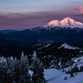 A view of Mount Shasta at sunset from Middle Peak.- Middle Peak Snowshoe