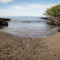 The trail crosses this small beach, which is a mouth for a creek bed that evidently flash floods from time to time.- Ala Kahakai National Historic Trail: Spencer Beach to Mau'umae Beach