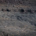 Hikers enjoying the Kīlauea Iki 400 feet below the overlook.- Devastation Trail
