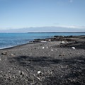 The black sand and pebble beach southwest of the main parking area and near the campsites.- Kīholo State Park Reserve