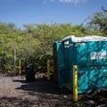 Portable toilets at Kīholo Bay State Park Reserve.- Kīholo State Park Reserve