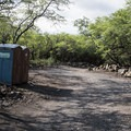 Portable toilets near the road are just a short walk from the campsites.- Kīholo State Park Reserve Campground