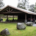 The picnic shelter at Nāmakanipaio Campground.- Nāmakanipaio Campground + Cabins