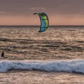 Kite surfer with an oil rig on the horizon.- Jalama Beach Campground