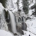 Contributor Shane Kucera at the base of 335-foot Falls Creek Falls.- Falls Creek Falls Snowshoe