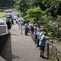 Spectators line up at the overlook for Rainbow Falls.- Rainbow Falls near Hilo