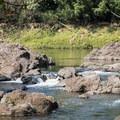 Swimming holes upstream from Rainbow Falls.- Rainbow Falls near Hilo