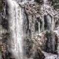Falls Creek Falls with massive snowflakes falling.- Falls Creek Falls Snowshoe