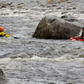 Kayakers practicing in some of the deeper currents.- Lower Capilano River Valley