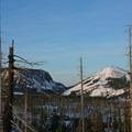 Hoodoo Ski Area and Hayrick Butte waking up.- Three Fingered Jack Backcountry Ski: South Ridge