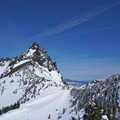 The first really good view from Three Fingered Jack with the southwest bowl below.- Three Fingered Jack Backcountry Ski: South Ridge