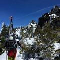 Picking the way through the rocks and brush.- Three Fingered Jack Backcountry Ski: South Ridge
