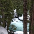 Impossibly green waters churn below cascades on the McKenzie River.- Sahalie + Koosah Falls Snowshoe
