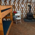 Cozy accommodations in a backcountry yurt.- Arizona Nordic Village Cabins + Yurts