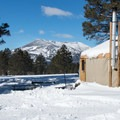 View of Kendrick Peak from one of the backcountry yurts.- Arizona Nordic Village Cabins + Yurts